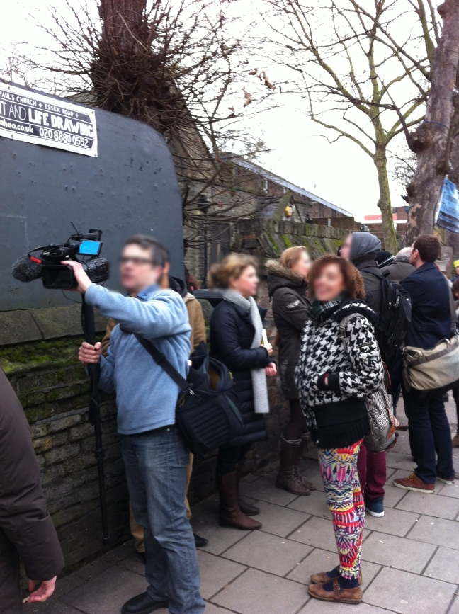 "People ""queuing up"" to attend the second-ever service of The Sunday Assembly. Media reporters captured every moment."